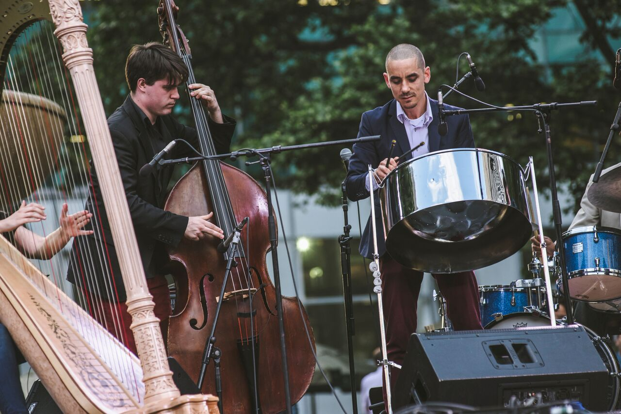 Andy Akiho performing on steel pans along with harp and double bass during the June 10, 2016 IN/TER\SECT concert in Bryant Park