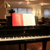A Mozart piano music score sits on Bright Sheng's grand piano.