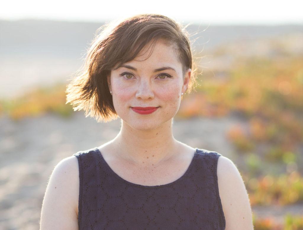 Jennifer Jolley standing near a lake