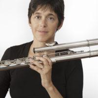 Lisa holding a bass flute