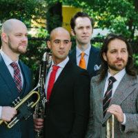 Outdoor photo of multi-instrumental ensemble