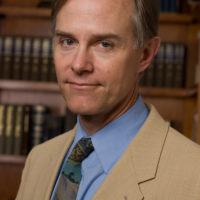 Caucasian man in tan suit