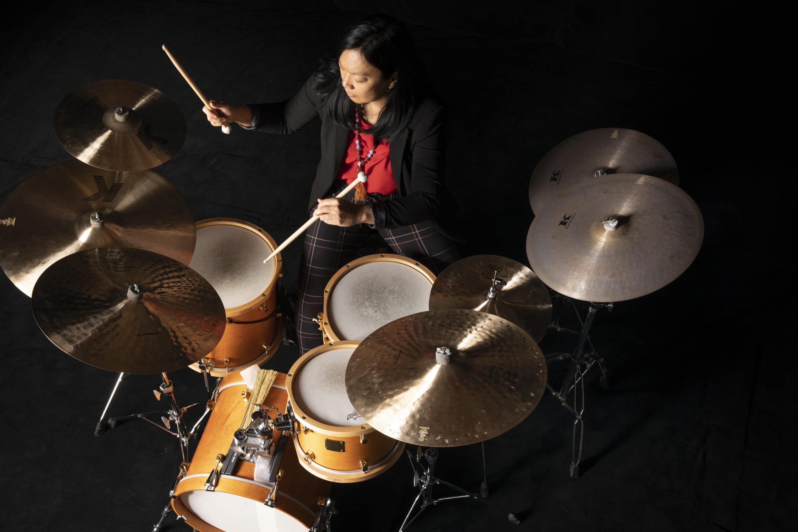 Susie Ibarra performing on a drum kit
