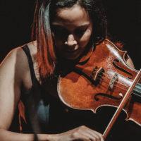 Big Ears Festival; an image of violinist Rhiannon Giddens performing
