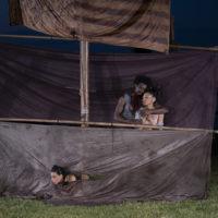 Dancers outside between sheets