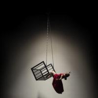 Dancer Megan Lowe swinging from the air